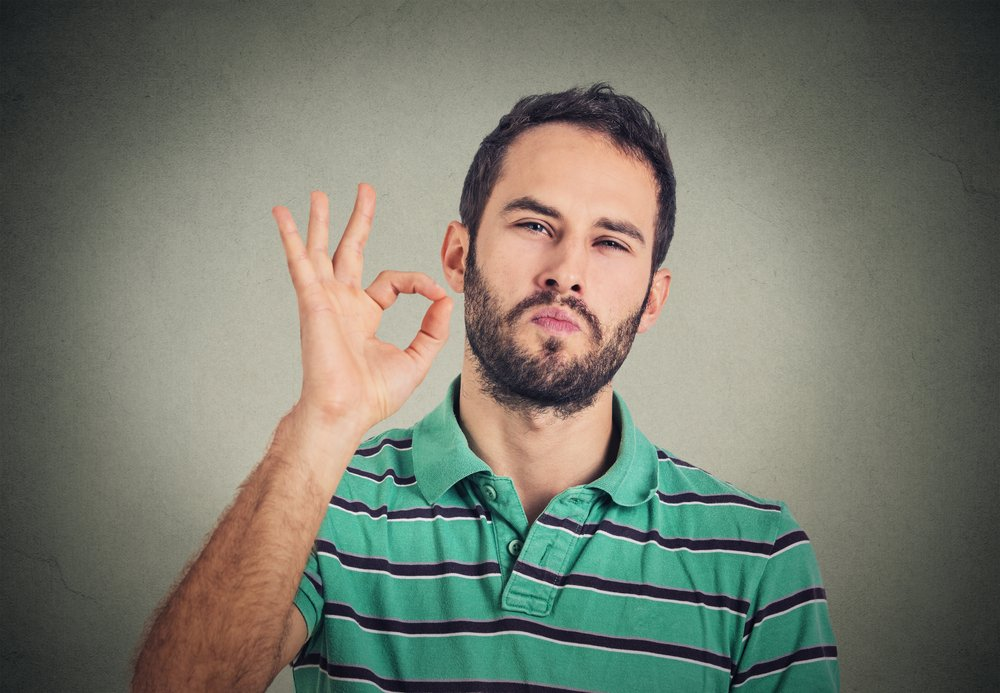 Everything-is-OK-Happy-young-man-gesturing-OK-sign